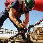 ouvrier sur chantier pantalon de travail noir